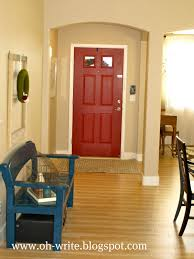 exciting entry room design with paint front door and sisal carpet