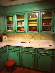 just showing off my antiqued turquoise cabinets i just did for