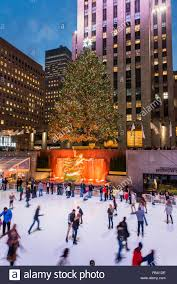 lower plaza of rockefeller center with ice skating rink and