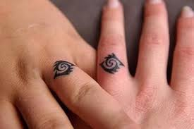 Christian Ring Tattoos 43 Awesome Wedding Ring Tattoos Weddingomania