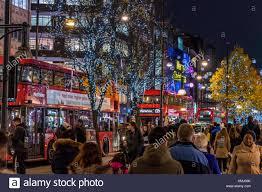 london christmas lights walking tour london buses drive along oxford st at christmas with christmas