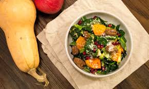 a thanksgiving time of year kale salad with brussels and butternut squash cooking in the creek