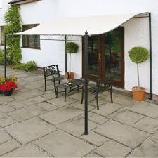 glass door canopies modest iron table sets on decorative paver floor under plain white