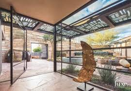 entry vestibule open glass vestibule entrance courtyard with stone and steel