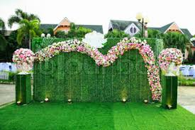 wedding backdrop grass wedding arch on the grass stock photo colourbox