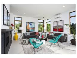 sofa high ceiling area rug glass panel railing catwalk gray