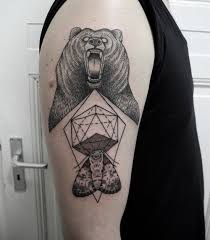 evil black bear and geometric tattoo for men on upper arm