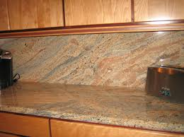 pictures of kitchen backsplashes with granite countertops granite and tile backsplash ghibli granite countertop with