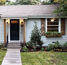 hgtv u0027s fixer upper home exterior love the wood shutters and