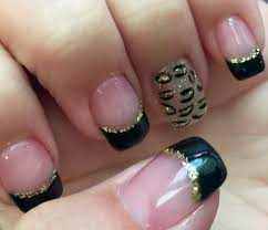 nails love black and gold black tips with gold line