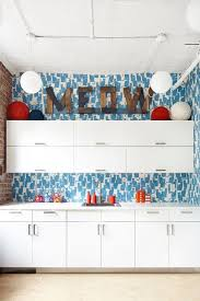 what to put on top of kitchen wall cabinets 14 ideas for decorating space above kitchen cabinets how