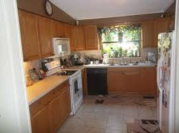 staining kitchen cabinets darker before and after can i stain my oak cabinets a darker color