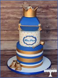 prince themed baby shower cake in royal blue and gold with crown