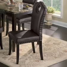 marble look dining table and nailhead chairs from seventh avenue