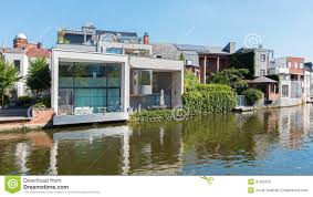 mechelen modern family house on waterfront of canal stock photo
