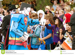kids halloween cartoon superman cartoon character fist bumps kids at halloween parade