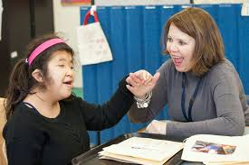 Teaching Deaf Blind Students Kimi Smiles As She Enjoys A B Perkins For The Blind