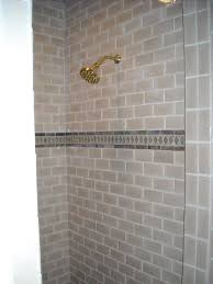gray and white gradation shower tile design come with metal look
