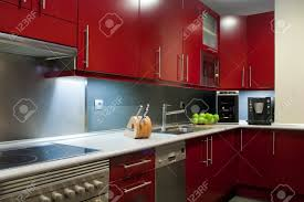 red modern kitchen modern kitchen in red and grey colors stock photo picture and