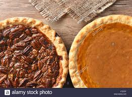 closeup of two pies on a thanksgiving table pumpkin and