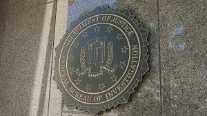 federal bureau of justice fbi seal zoom in on federal bureau of investigation headquarters