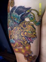 angry fu dog tattoo on biceps real photo pictures images and