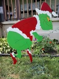 Grinch Stealing Christmas lights Yard Art Decoration