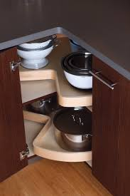 kitchen corner cabinet storage ideas our giant turntable shelves swivel inside the cabinet and utilaze