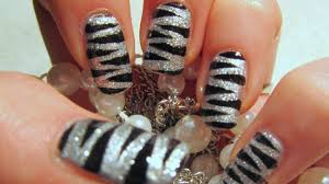 new years 2011 silver glitter tiger print design nail art tutorial