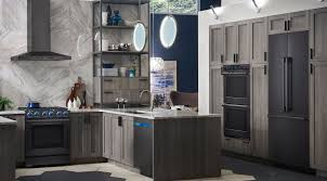gray kitchen cabinets with black stainless steel appliances what s the deal with black stainless steel climatic home