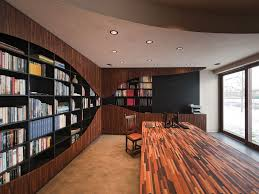 fantastic home library interior decor with long wooden table also