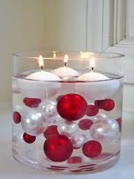 large glass cylinder with ornaments and floating