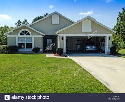 two car garage home in florida stock photo royalty free image