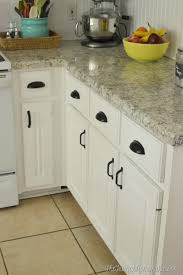 black pulls for white kitchen cabinets how to re paint your yucky white cabinets the frugal homemaker