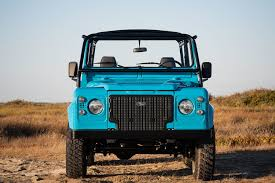 turquoise jeep a gorgeous land rover defender restoration