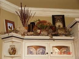 above kitchen cabinet decor ideas 42 best decor above kitchen cabinets images on kitchen
