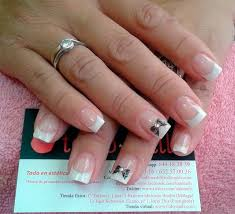 imagenes de uñas decoradas con konad uñas acrílicas con francesa blanca y lazo realizado con placas konad