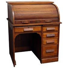 solid oak roll top desk 1920s solid oak roll top desk with recessed panels and five drawers