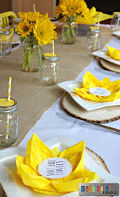 paper napkin folding with sunflower table decorations