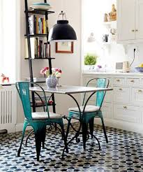unique floor tiles and teal metal chairs for cottage style kitchen