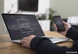 Laptop On Desk User With Smartphone And Laptop On Desk Mockup 3 Buy This Stock