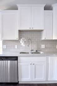 kitchen backsplash white cabinets subway tile white cabinets faucet and gray