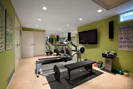 basement gym home gym midcentury with recessed lighting wall mount tv