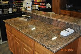 furniture starmark cabinets with mosaic tile backsplash and brizo