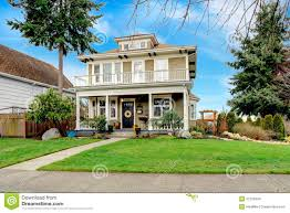 typical american craftsman style house with column porch stock