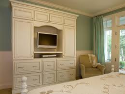 bedroom entertainment center the elegant white armoire provides functional storage and doubles as