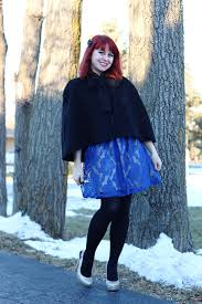 a holiday blue lace dress black capelet and sparkly heels