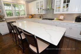 espresso kitchen cabinets with white countertops calcatta classique quartz great alternative to calcatta marble