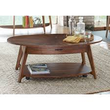 oval cocktail table with casters by liberty furniture wolf and