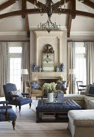 traditional living room with cement fireplace u0026 high ceiling